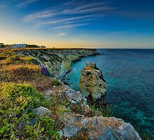 Coastline at sunset  by Andrea Rapisarda
