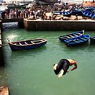 Diving off the castle in Essaouira by jwgrayman