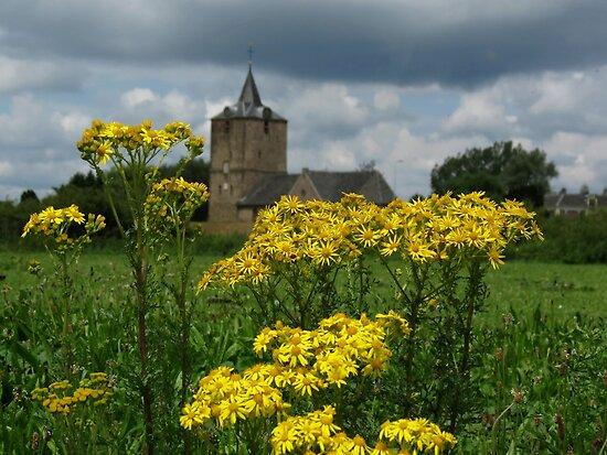 Church behind flowers by Peter Wiggerman