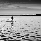 Lone paddler on Lake Veere. by M. van Oostrum