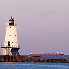 Ludington (Michigan) Light and Large Ship by Kenneth Keifer