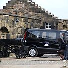 Cannons at Half Moon Battery inside Edinburgh Castle and van by ashishagarwal74