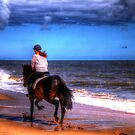 Horse and rider on beach by SimplyScene