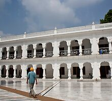 Sikh man walking inside the Golden Temple by ashishagarwal74
