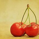 four cherries by Iris Lehnhardt