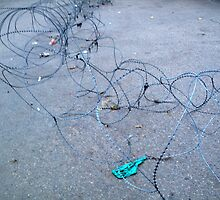 Concertina wire along the ground barring entry to a location by ashishagarwal74