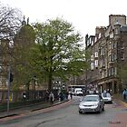 Cars on a road in Edinburgh by ashishagarwal74