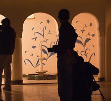 Photographers in silhouette at a heritage building in Rajasthan, India by ashishagarwal74