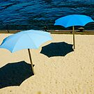 Blue umbrella on the beach 2 by Denis Charbonnier