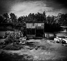 House on stilts in rural Thailand by hangingpixels
