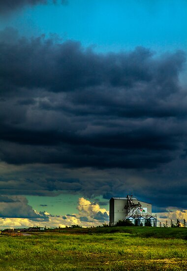 Grain mill and storm clouds by alan shapiro