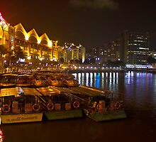 Boats moored to the side at Clarke Quay in Singapore by ashishagarwal74