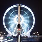 Paris Champs Elysees Obelisk and ferris wheel of La Concorde at night  by Pat Garret