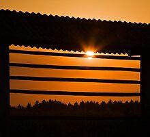 Hazy summer sunset by Ian Middleton