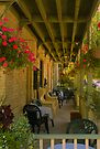 Porch of the Little Inn in Bayfield Ontario by Yukondick