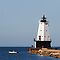 Ludington Light and Fishermen by Kenneth Keifer