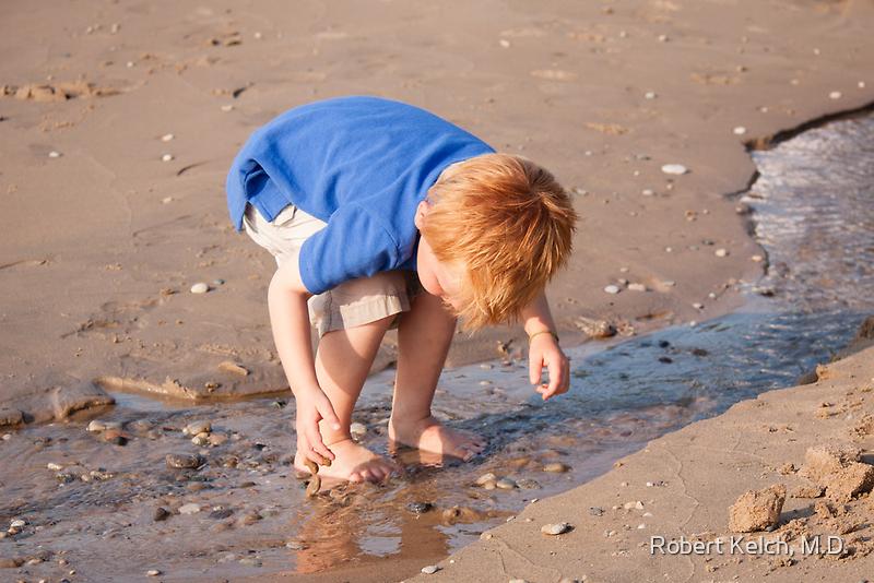 A Curious Boy at the Beach by Robert Kelch, M.D.