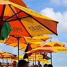 Orange Umbrellas in Brazil by oftheessence