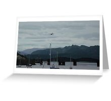 Hercules plane flying over Barmouth Greeting Card