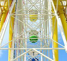 Ferris wheel against a blue sky  by kawing921