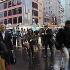Melbourne crossing the road in the rain by Trevor Corran