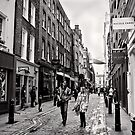 An afternoon shopping in London - Britain by Norman Repacholi