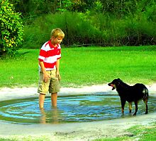 zack and the dog in a puddle by tomcat2170