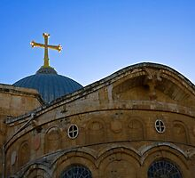 golden cross on the roof of the church of the Holy Sepulchre by PhotoStock-Isra