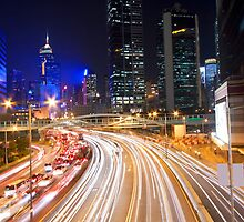 Traffic in Hong Kong downtown at night by kawing921