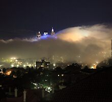 High view of Sydney city in fog at night, Australia by Sharpeyeimages