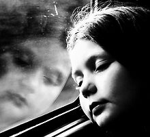 Child's reflection in train window by melek0197