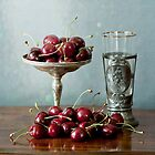 Cherries on a silver plate and an ancient glass by Luisa Fumi