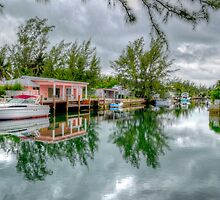Reflections on The Canal at Coral Harbour Town in Nassau, The Bahamas by 242Digital