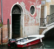 Pink wall, red boat by Karen E Camilleri
