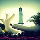 Varada Mudra hand sculpture and Guanyin statue, Sanya, China by Chris Millar