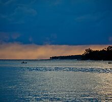 Silhouetted single boatman on water, Vanuatu, South Pacific Ocean by Sharpeyeimages