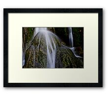 Waterfall flows over round rock, Vanuatu, South Pacific Ocean Framed Print