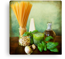 Italian recipe: noodles with pesto (basil,parmisan,garlic,olive oil,pine nuts) Canvas Print