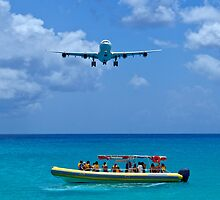 Passenger airplane overflies boat. by FER737NG