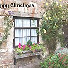 Christmas card - Lindisfarne rose covered cottage by BronReid