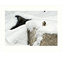 Hiker on snowy cliff Art Print