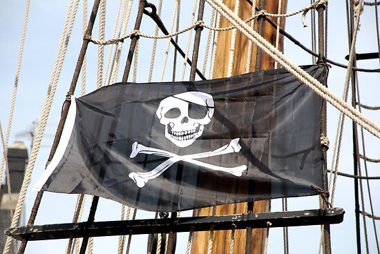 Skull and crossbones pirate flag on tall ship, Plymouth, Devon, UK by silverportpics