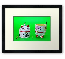 Playing golf on cat cups Framed Print