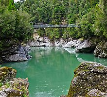 Swing bridge over New Zealand River by Clive Roper