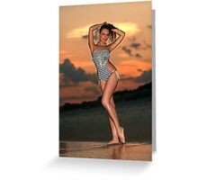 Beautiful brunette posing sexy at the beach during golden sunset time Greeting Card