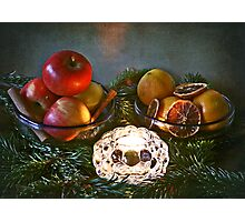 Christmas:a candle, fir branches spices and fruits Photographic Print