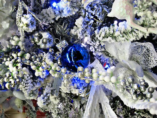 A Beautiful Blue Christmas Ball On A Snowy Tree by Jane Neill-Hancock