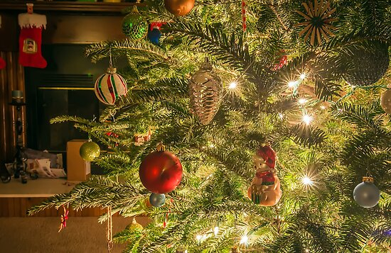 Still life photo of christmas presents and christmas tree in the living room. by Alexandr Grichenko