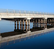 cashen road bridge over cold blue river reflected by morrbyte