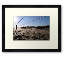 ice coated wire fence in a farm field Framed Print